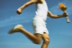 Athlete Holding Sport Torch Blue Sky Stock Image