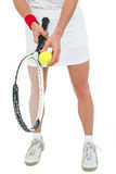 Athlete holding a tennis racquet ready to serve Stock Photo