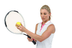 Athlete holding a tennis racquet ready to serve Stock Image