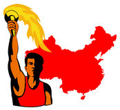 Athlete holding a torch Stock Photos