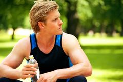 Athlete Holding a Water Bottle Stock Photography
