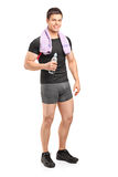 Athlete holding a water bottle after exercise Royalty Free Stock Photos