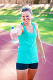 Athlete holding a water bottle Stock Image