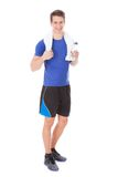 Athlete holding water bottle in hand after exercising Stock Image