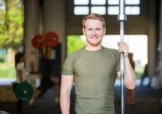 Athlete Holding Weightlifting Bar At Gym Stock Photo