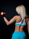 Athlete holding weights Stock Photography