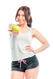 Athlete holds a green apple Stock Photography
