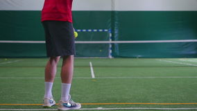 The athlete holds two balls and tennis racket stock video