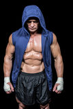 Athlete in hood looking down Royalty Free Stock Photos