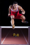 Athlete on hurdle in track and field Royalty Free Stock Photos