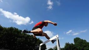 Athlete in hurdling stock video