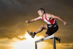Athlete in hurdling. In sundown Royalty Free Stock Photography