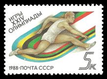 Athlete on the hurdling. USSR - CIRCA 1988: Stamp printed by USSR, Multicolor edition on topic of Seoul Summer Olympic Games 1988, shows athlete on the hurdling