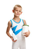 Athlete with jar of vitamins Royalty Free Stock Images