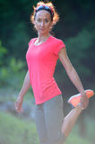 Athlete Jogger Stretching Legs outdoors, Preparing To Run. Woman Royalty Free Stock Image