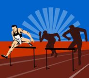 Athlete jumping hurdles stock image