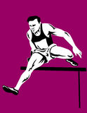 Athlete jumping hurdles Royalty Free Stock Photography