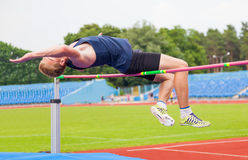Athlete jumps in height Royalty Free Stock Photography
