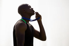 Athlete kissing his gold medal Royalty Free Stock Image