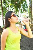 Athlete lady drinking water Stock Photography