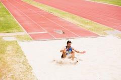 Athlete landing on sandpit Stock Image