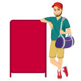Athlete leaning against a red blank board Stock Image