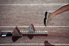 Athlete leaving the starting blocks Stock Images