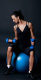 Athlete lifting weights in dark gym Royalty Free Stock Photography
