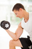Athlete lifting weights Stock Photography