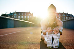 Athlete limbering up before her workout Royalty Free Stock Image