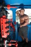 Athlete in locomotive cabin full body Stock Photography