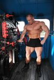 Athlete in locomotive cabin full body Stock Photo