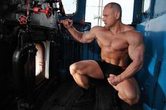 Athlete looks in  locomotive fire chamber Stock Image