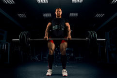 Athlete makes a deadlift. He fixed the bar at the top. And waits for a count Stock Photography