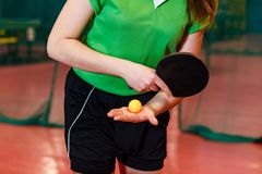 The athlete makes a submission in table tennis, arm and racket close. Indoors royalty free stock images