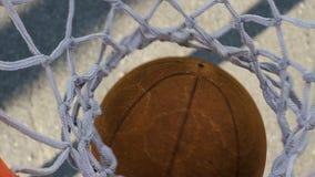 Athlete making jump hook shot and winning basketball tournament, success. Stock footage stock video