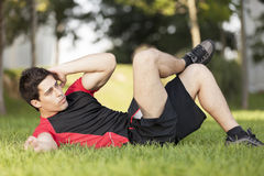 Athlete making some abdominals Stock Images