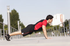 Athlete making some pushup Stock Images