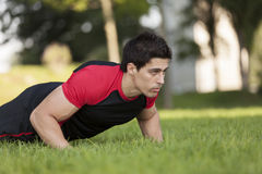 Athlete making some pushup Royalty Free Stock Photos