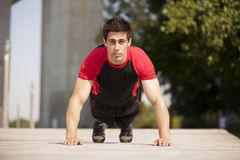 Athlete making some pushup Stock Photography