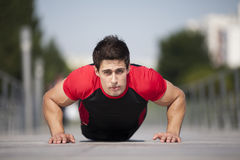 Athlete making some pushup Stock Photos