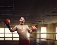 Athlete male asian boxer doing uppercuts on training Royalty Free Stock Images