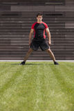 Athlete male on the grass Stock Photo