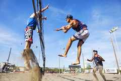 Athlete man beach volleyball jumping spike attack. Defense. Royalty Free Stock Photos