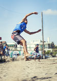 Athlete man beach volleyball jumping spike attack Royalty Free Stock Photo