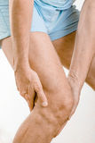 Athlete man feeling pain to the knee. It could be medial meniscus tears, injuries of the collateral lligament, bursitis or Iliotibial band syndrome stock photography
