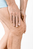 Athlete man feeling pain to the knee and to the quadriceps Stock Image