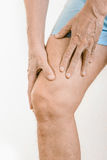 Athlete man feeling pain to the quadriceps. Athlete man massaging a painful  quadriceps after an accident. It could a musculaire claquage or a muscle elongation Stock Image