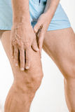 Athlete man feeling pain to the quadriceps. Athlete man massaging a painful  quadriceps after an accident. It could a musculaire claquage or a muscle elongation Stock Photo