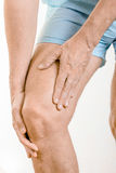 Athlete man feeling pain to the quadriceps and to the knee Stock Photography
